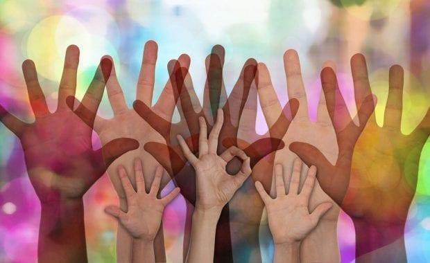 Volunteering hands being raised