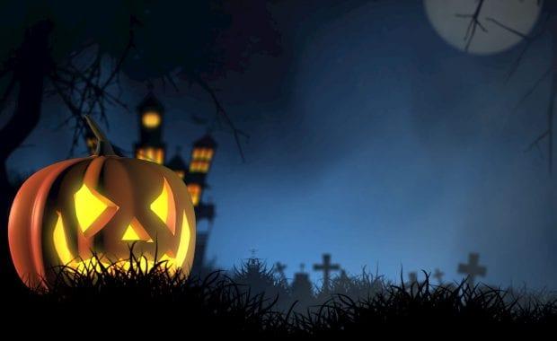 Halloween pumpkin in a graveyard